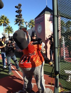 Batkid hugging Giants Mascot